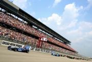 Dario Franchitti leidt de start van de Champ Car race op de Chicago Motor Speedway in 2002