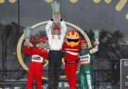 Helio Castroneves, Graham Rahal en Tony Kanaan op het podium in St. Petersburg