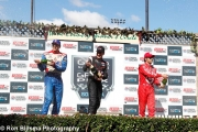 Justin Wilson, Will Power en Dario Franchitti op het podium van Sonoma
